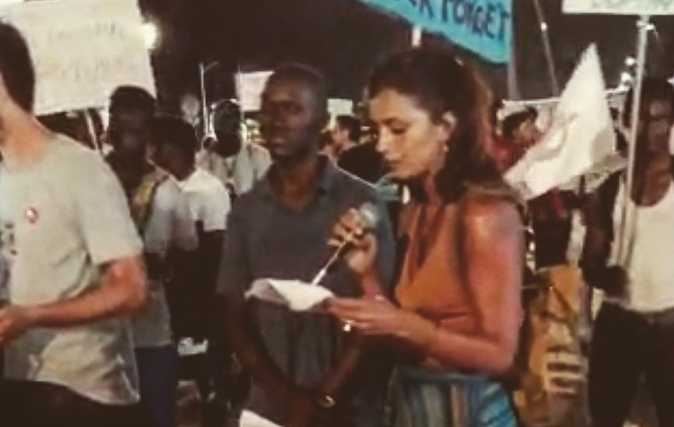 Nicoletta Russo mentre legge l'intervento alla manifestazione di Rimini Dalle radici alle stelle. Marcia per i diritti contro lo sfruttamento